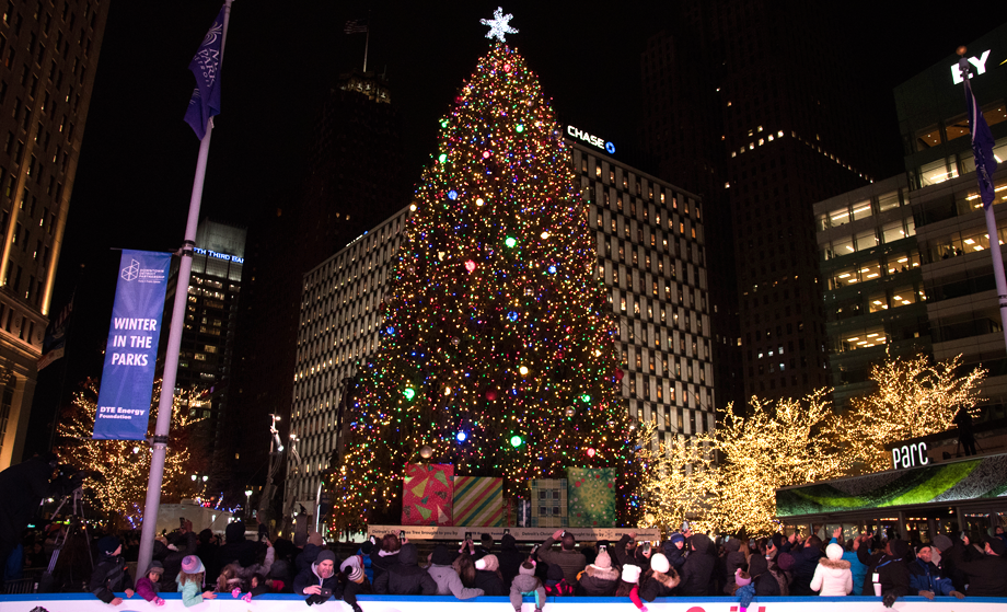 People gather around the fountain during the annual tree lighting event at Campus Martius Park in downtown Detroit on Friday night, November 16, 2018.
